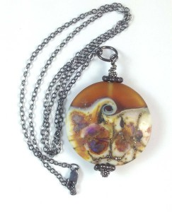 "This pendant, called ""Amber Ocean"" by Carolyn Muir of Port Dover is available at 100 Mile Gifts."